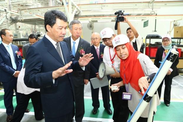 Negeri Sembilan Menteri Besar Dato' Seri Utama Haji Mohamad Haji Hasan and State Secretary Dato' Haji Mat Ali Hassan and Japan Ambassador Dr Makio Miyagawa being briefed by staff at the Hino Motors Sendayan plant