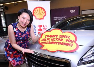 A radiant Mrs K'ng Choo Wei and her family's shiny Peugeot SUV_2_1