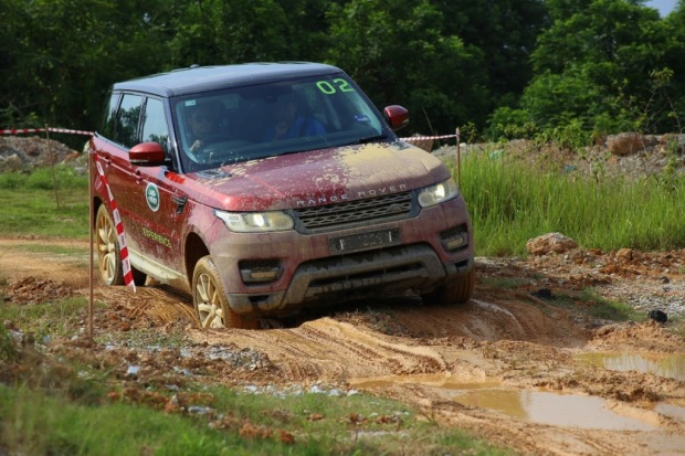 A Range Rover Sport taking on elephant steps with aplomb